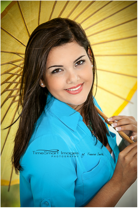 senior with blue yellow umbrella