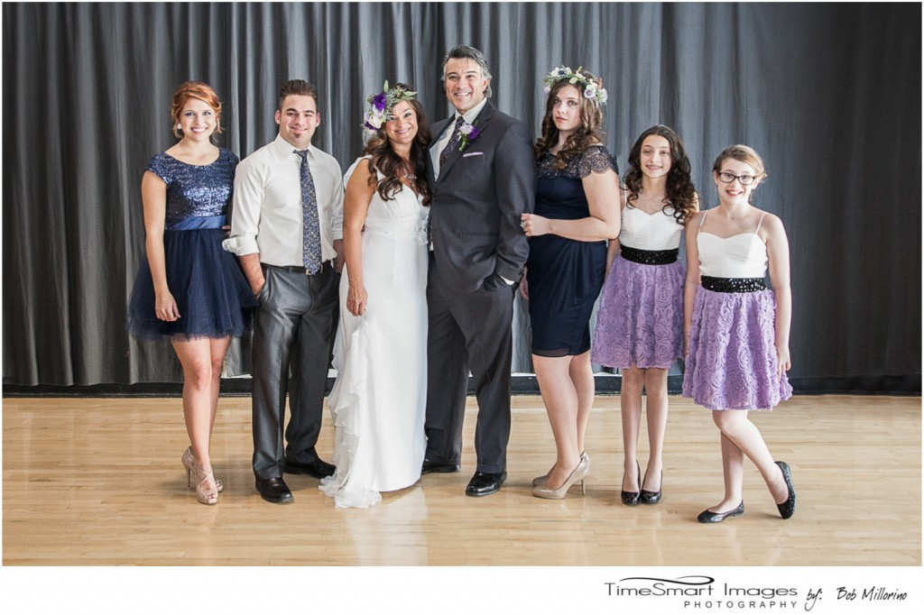 wedding family in purple in grey
