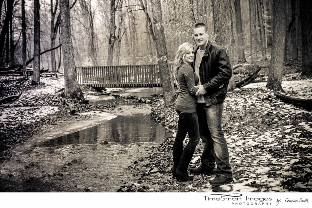 winter engagement in woods by creek