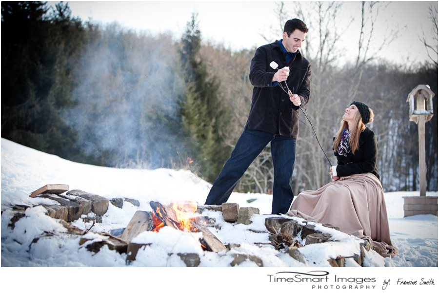 pittsburgh winter engagement with campfire and marshmellows