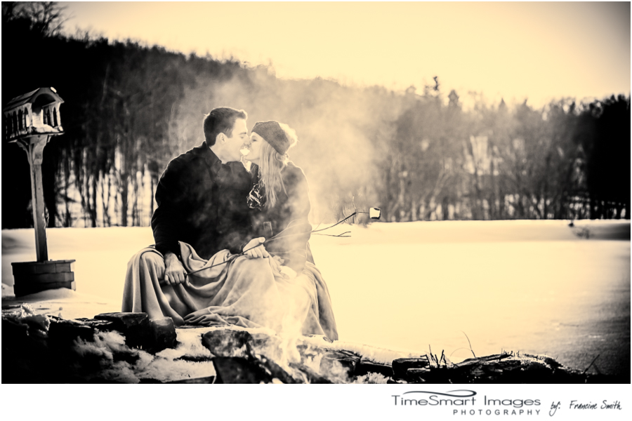 winter engagement, sunflair, campfire, smoke, marshmellows