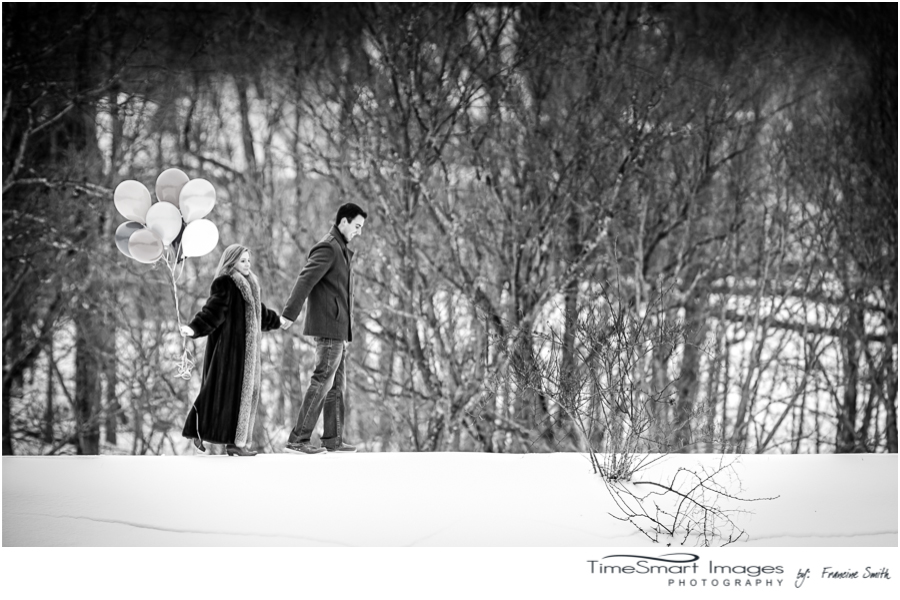 winter engagement with balloons
