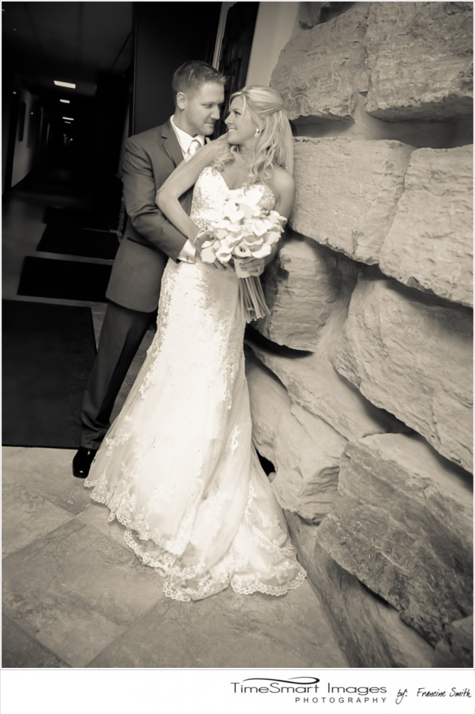 Bride and Groom by Stone Wall