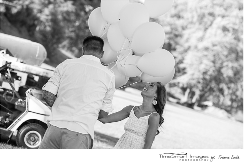 Engagement by the water with balloons