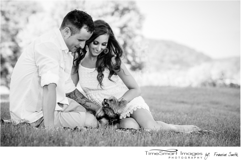 Engagement with puppy by the water