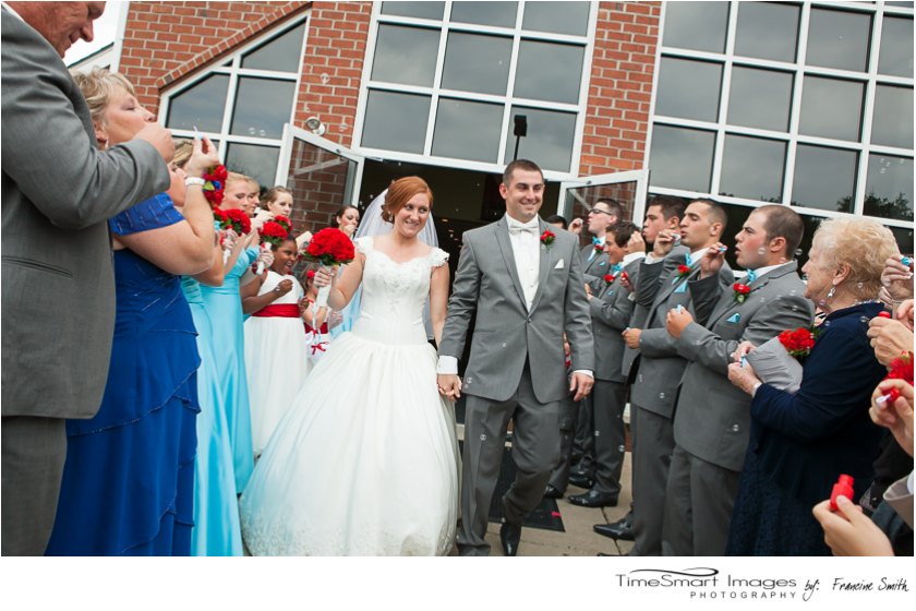 bride and groom and bubbles
