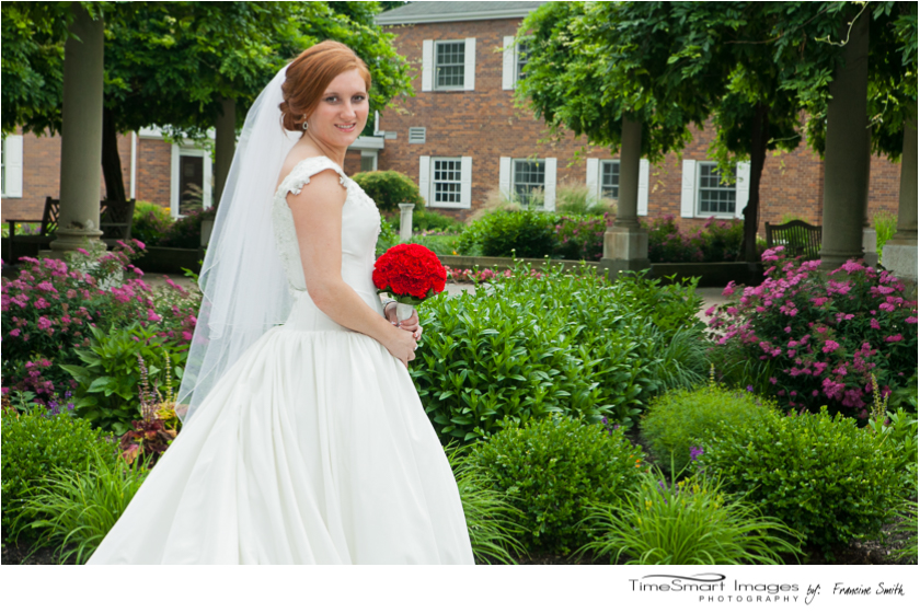 bride in garden with flowers