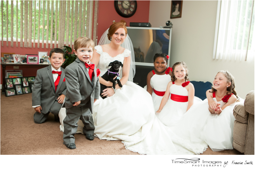 bride with ring bearers and flowers girls