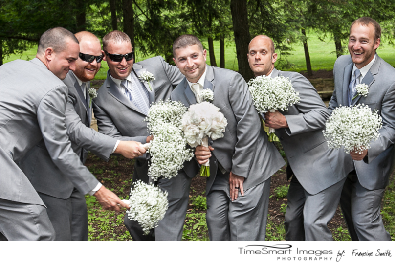 fun groom and his guys with flowers
