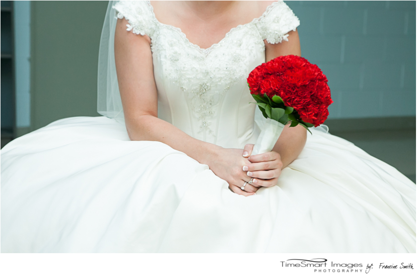 wedding dress, red carnations